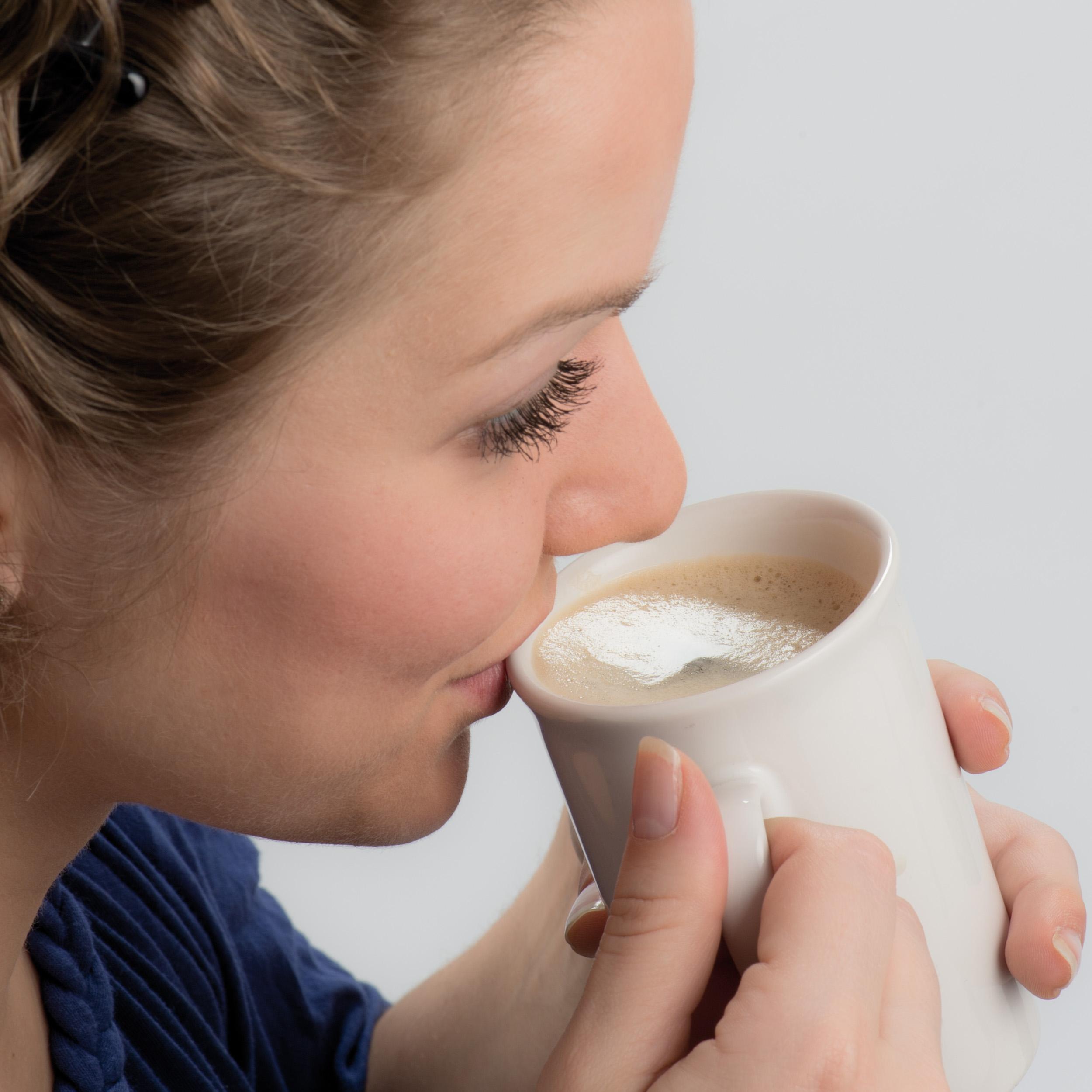 White ceramic coffee mug with a corrugated scum